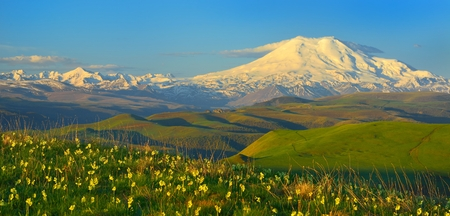 This is colorful Elbrus in Caucasus mountains in beginning summer photo