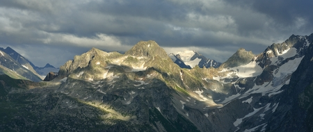 somber: This is wild summits in Caucasus mountains in evening
