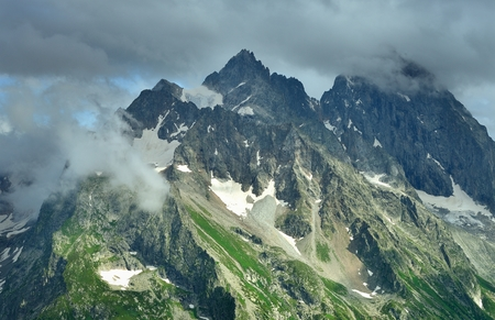 somber: This is gloomy summit in Caucasus mountains in summer