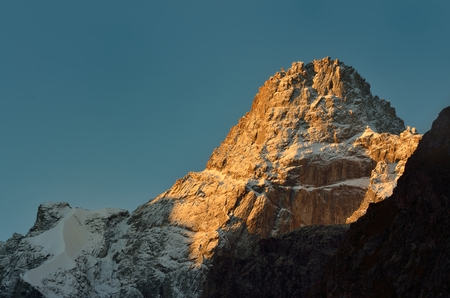 snow break: This is morning summit in Caucasus mountains in fall Stock Photo