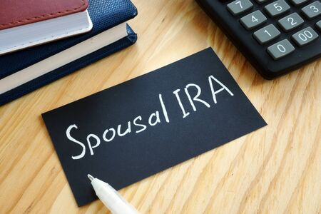Conceptual hand written text showing Spousal IRA