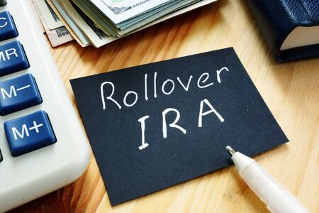 Business photo shows hand written text Rollover IRA