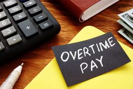 Text sign showing hand written words Overtime pay 写真素材