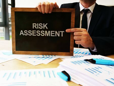 Writing note shows the text risk assessment