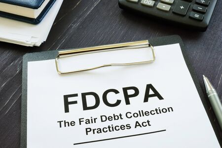Writing note shows the text FDCPA The Fair Debt Collection Practices Act