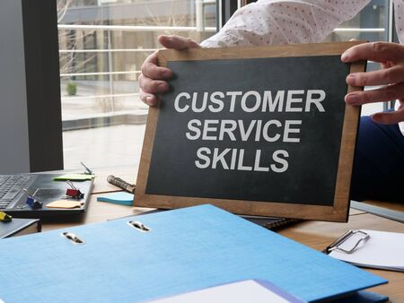Writing note shows the text Customer Service Skills