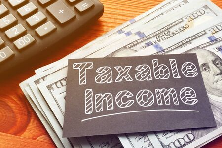 Taxable Income is shown on the conceptual business photo