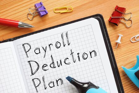 Payroll Deduction Plan is shown on the conceptual business photo Stock Photo