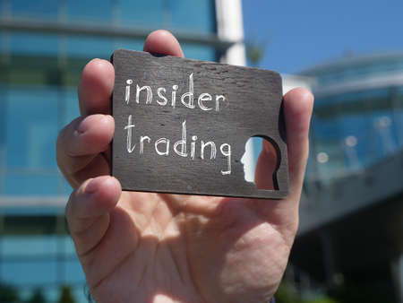 Insider trading is shown on the conceptual business photo