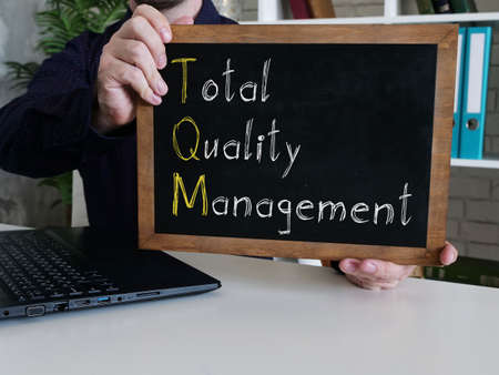Total Quality Management TQM is shown on the conceptual business photo Standard-Bild