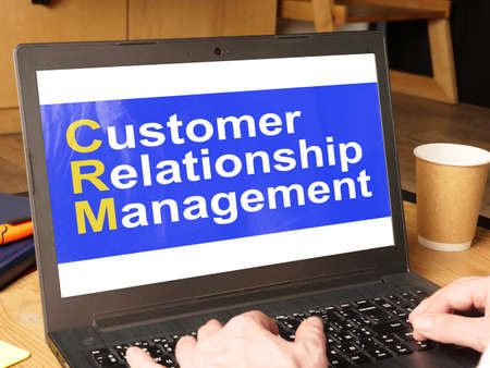 Customer Relationship Management CRM is shown on the conceptual business photo