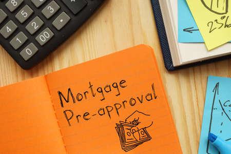Mortgage pre-approval is shown on the conceptual business photo Foto de archivo