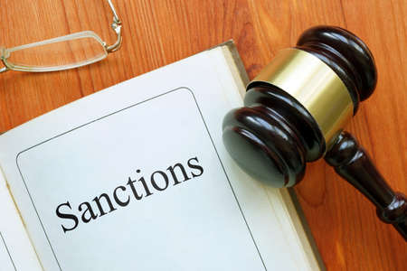Sanctions is shown on the conceptual photo using the text Stock Photo