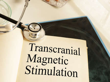 Transcranial Magnetic Stimulation TMS is shown on the photo using the text