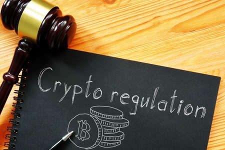 Crypto regulation is shown on a business photo using the text