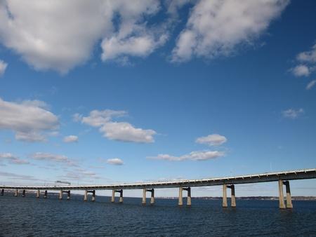 bridge over water: Ascending Bridge Over Water Stock Photo