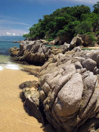 Rock Outcroppings by Las Caletas, Beach in Puerto Vallarta Mexico  Stock Photo
