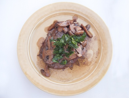 Plate of Filet Mignon topped with mushrooms and parsley