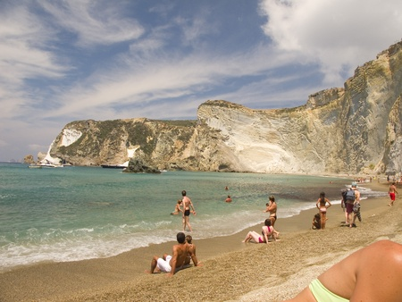 Beachgoers at Beach in Ponza, Italy with female shoulder in bottom right foreground