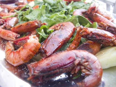 Closeup of Cooked Large Red Shrimp on a bed of salad greens photo