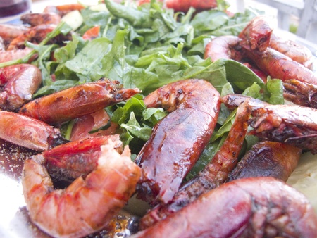 Closeup of Cooked Large Red Shrimp on a bed of salad greens