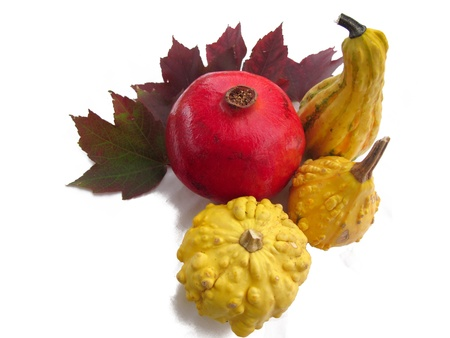 Pomegranate and Yellow Gourds Isolated on White Background Stock Photo