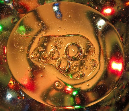 refracting: Oil Droplets in Water Refracting a Colored Light Pattern Display