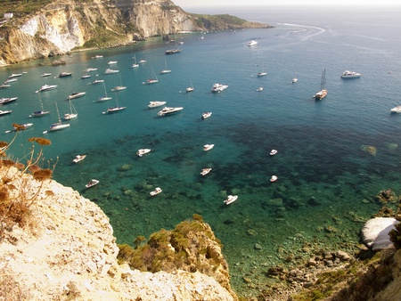 Aerial view of the coastline of Ponza, Italy.  Sailboats anchored along the water