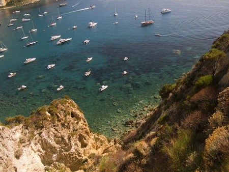 Downward view from a cliff - Turquoise green bay with sailboats and ships