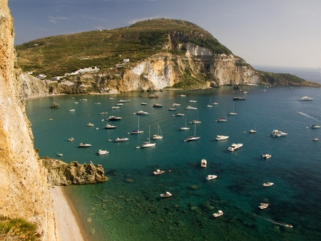 Aerial view of Chiaia di Luna Bay at Ponza, Italy.  Boats and yachts anchored along the mountain coastline in turquoise waters