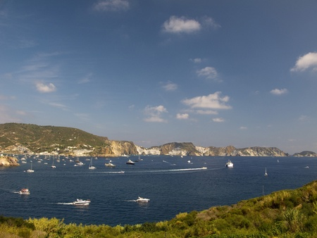 View of Coastline of Ponza, Italy.  Boats and transportation in the blue waters.  Copy Space available in sky area.