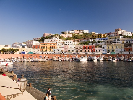 Main port and harbor.  Architecture and colored houses along a mountain