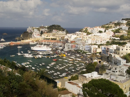 View of the main port of Ponza, Italy.  Hill and Coastline in prominent view.