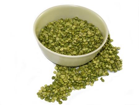Dry Split Peas in green bowl, white background