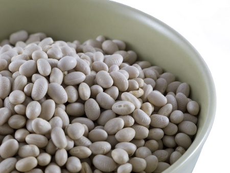 common bean: Detail of Dry White Navy Beans in a bowl (shallow depth of field for Detail) Stock Photo