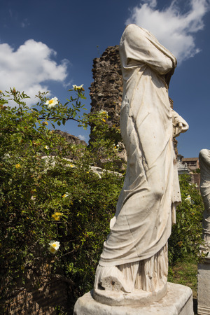 Headless Statue at the Ancient Roman Forum in Italy Stock Photo - 31605368