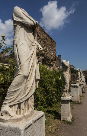 Row of headless marble statues in Roman Forum