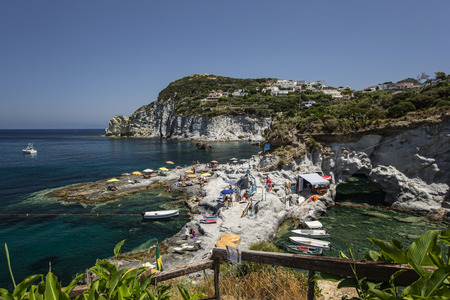 Panorama View of Mediterranean Island Coastline (Ponza, Italy). Sunbathers on the rocks Stock Photo