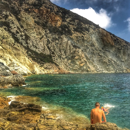 Bathers at a cliff by the sea. Ponza, Italy