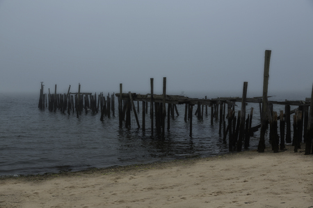 Scene of foggy pier and beach