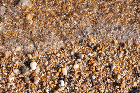 small sea stones and sand background texture