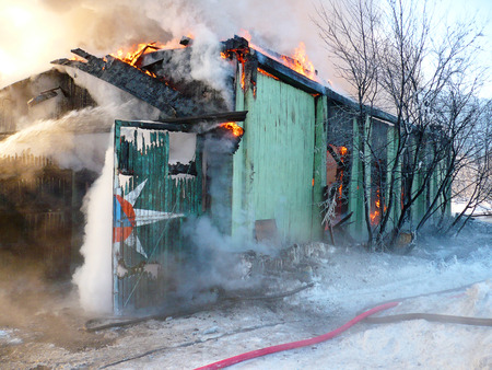 Firemen extinguish a house and building;