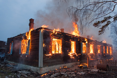 Firefighters extinguish a house and building Imagens - 71378649