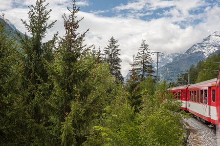 Electric red train in Tasch,Valais,Switzerland