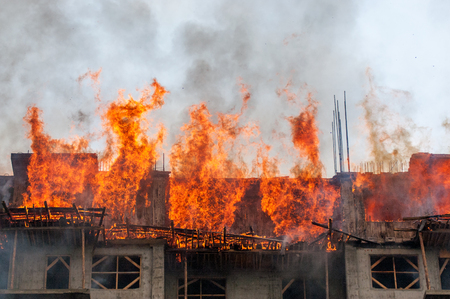 heat loss: Firefighters extinguish a house and building