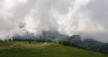 Alpine valley with morning fog. Beautiful natural landscape. Imagens