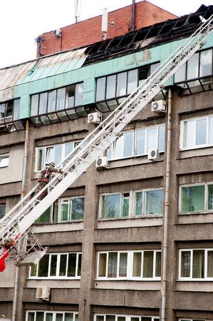 Fireman extinguish fire in buildings