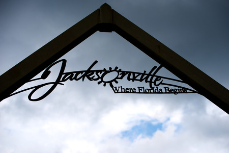 where: Jacksonville where it begins welcome sign against the storm sky