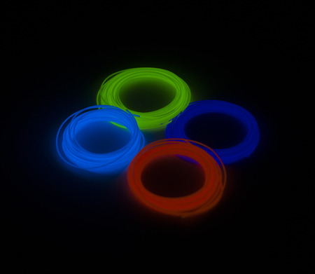3D Pen PLA Filament Refills glow in the dark color - 1.75mm ABS - 3d printing, 4 colors linear isolated on black background Stock Photo