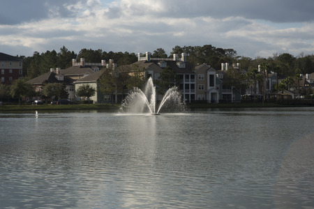 Typical apartment building with pond and fountain in Florida